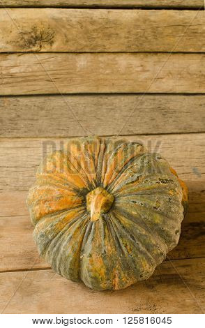 Still life with pumpkin on wooden table background
