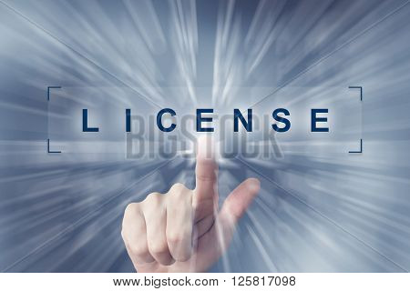 hand clicking on financial license button with zoom effect background