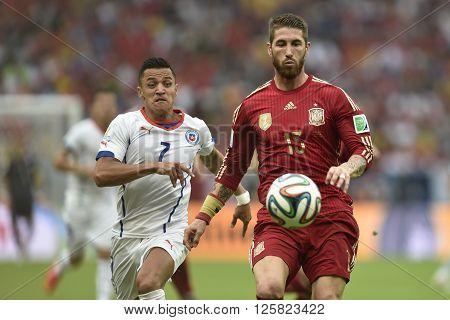 RIO DE JANEIRO BRAZIL - June 18 2014: Sergio RAMOS of Spain and Alexis SANCHEZ of Chile during the FIFA 2014 World Cup. Spain is facing Chile in the Group B at Maracana Stadium