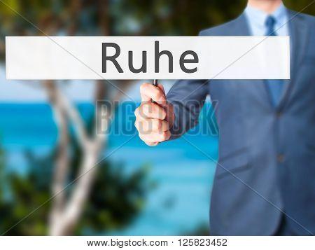 Ruhe (quiet In German) - Businessman Hand Holding Sign