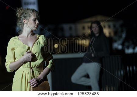 Criminal Following Young Woman