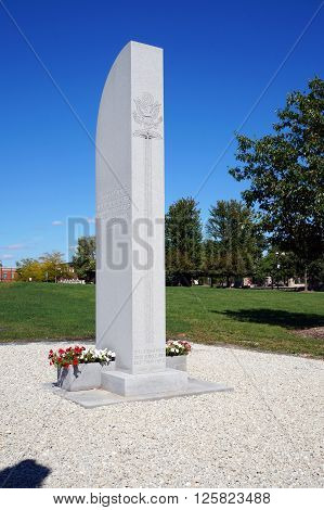 PLAINFIELD, ILLINOIS / UNITED STATES - SEPTEMBER 20, 2015: A memorial, to the men and women of Plainfield who served in the wars of our country, stands in Settlers' Park.
