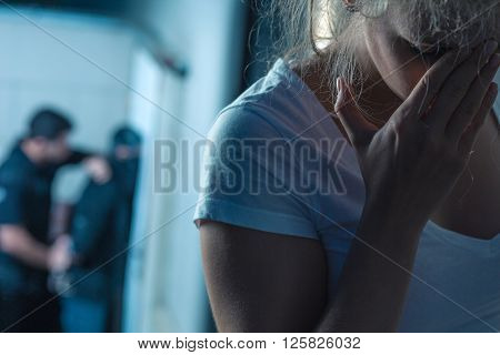 Horizontal picture of terrified young female victim poster