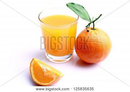 Glass of orange juice with sliced orange isolated on white background