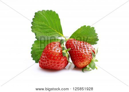 Fresh Two strawberries isolated on white background