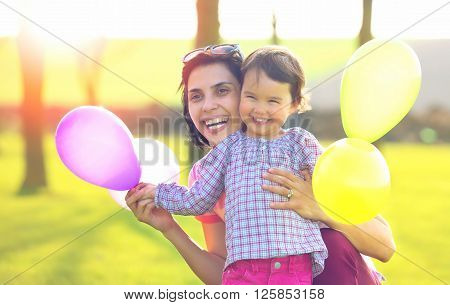 Happy loving family. mother and child girl playing