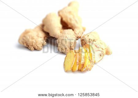 Close-up shot of sliced ginger isolated on white background