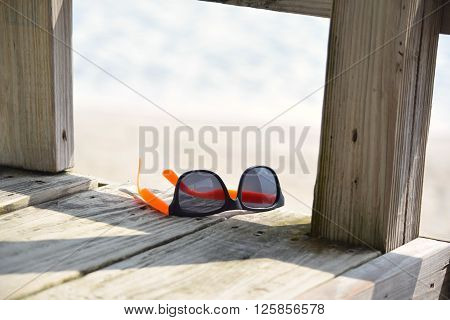 Sunglasses Left Behind on the Beach Boardwalk