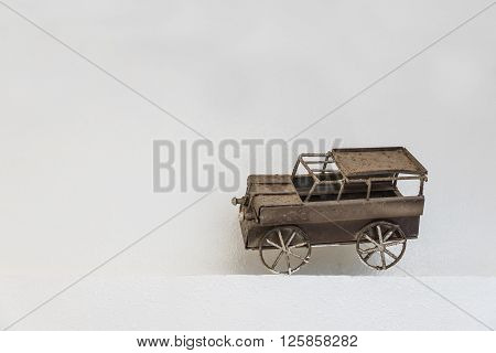 The old iron car for decoration with white background