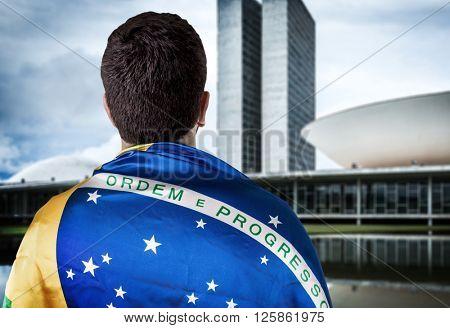 Brazilian holding the flag of Brazil in Brasilia