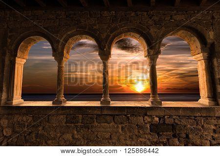 Sunset over the sea with cloudy sky. Church of San Pietro (1198) in Portovenere (UNESCO world heritage site) - La Spezia Liguria Italy