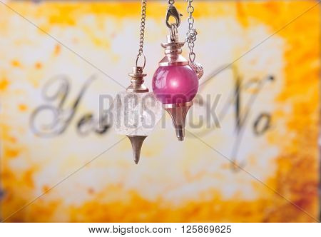 Pendulums, tool for dowsing over yes and no choosing diagram poster
