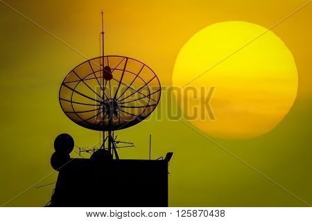 The silhouette of satellite dish sunset background