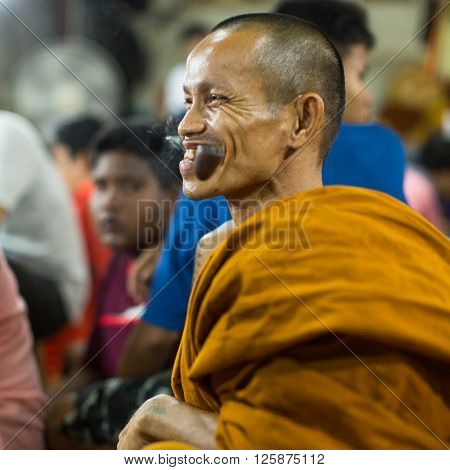 WAT BANG PHRA, THAILAND - MAR 19, 2016: Unidentified monk master Yantra Tattoos during Master Day Ceremony at Bang Phra monastery, about 50 km west of Bangkok.