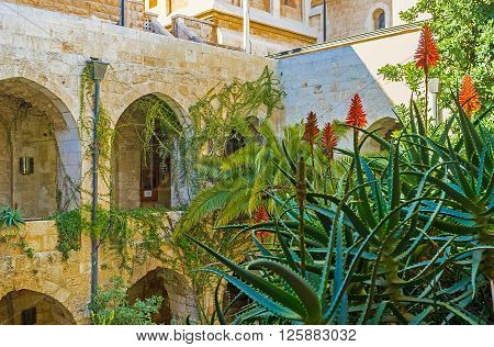 JERUSALEM ISRAEL - FEBRUARY 16 2016: The tropic garden in the courtyard of Lutheran Kirche of the Redeemer on February 16 in Jerusalem.