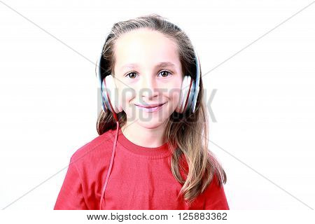 cute little girl with headphones isolated on white