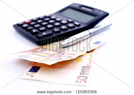 EURO currency with pencil and financial calculator