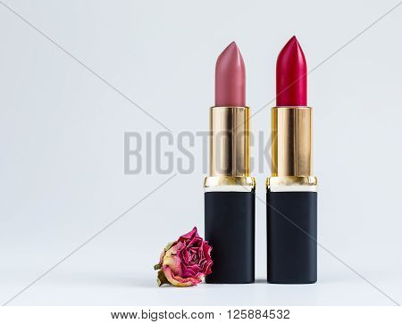 Red lipstick isolated on white background, cosmetics, make-up