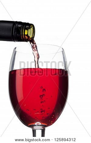 Close Up Shot Of Wine Bottle And Wine Glass On White
