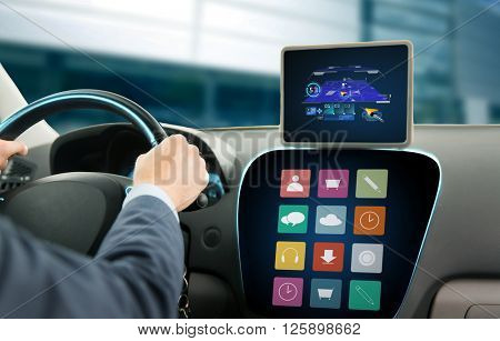 transport, business trip, technology, navigation and people concept - close up of young man with gps navigator on tablet pc and on-board computer menu driving car
