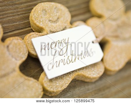image of gingerbread candies and merry christmas placard