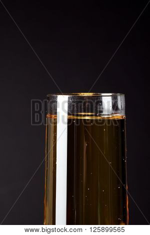 glass full of alcoholic drink isolated on a black background