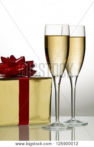 glass of wine with gift isolated on a white background