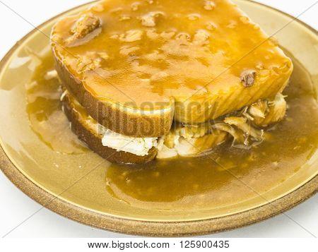 Gravy Being Poared Over Hot Turkey Sandwich