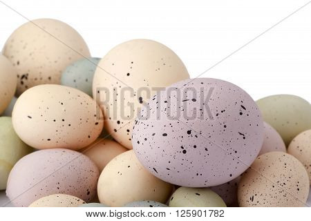 heap of colorful easter eggs isolated on a white background