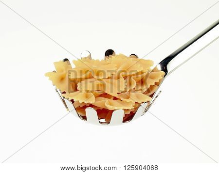 ladle of bowtie pasta isolated on white background