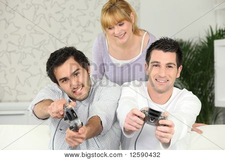 Young men having fun with a video game