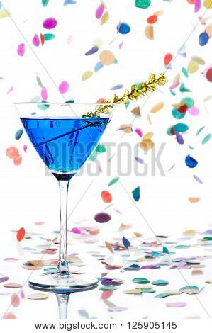 Martini Glass With Blue Alcohol And Yellow Streamer