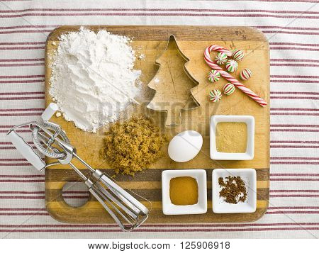 Overhead View Of Cake Ingredient With Cookie Cutter Candy Cane And Wire Whisk