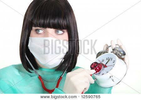 Nurse with stethoscope and clock