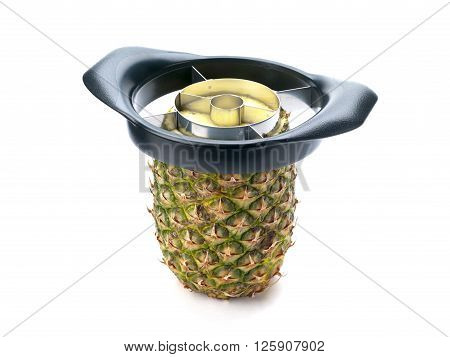 pineapple with slicer isolated on white background