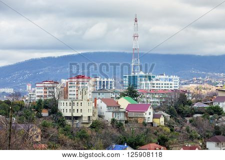 Houses on the background of mountains. Sochi. Russia