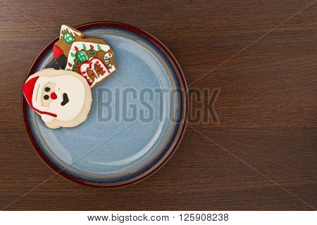 Plate Decorated With Santa And House Cookies