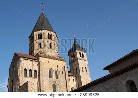 CLUNY FRANCE  - June 8 2014 : Cluny Abbey Clocktower. Cluny is the symbol of the monastic revival. The abbey was a leading intellectual center in the Middle Ages. Only a part subsists under protections of Historic monuments.