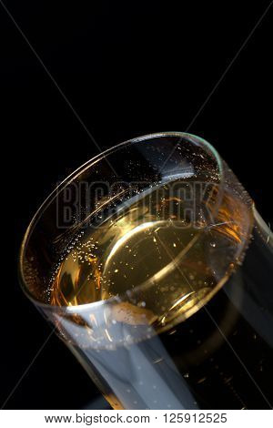 image of tilt glass filled with champagne