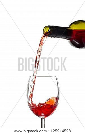 wine bottle pouring wine in glass isolated on white background