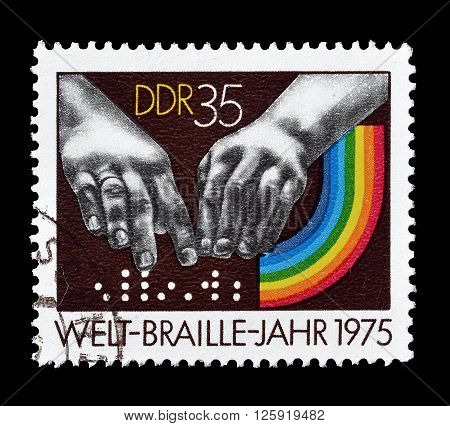 GERMAN DEMOCRATIC REPUBLIC - CIRCA 1975 : Cancelled postage stamp printed by German Democratic Republic, that shows Braille dots and hands.