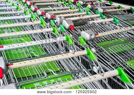 MOSCOW, RUSSIA-April 05. 2015. Lined up baggage trolleys at Leroy Merlin. Leroy Merlin is a French home-improvement and gardening retailer serving thirteen countries