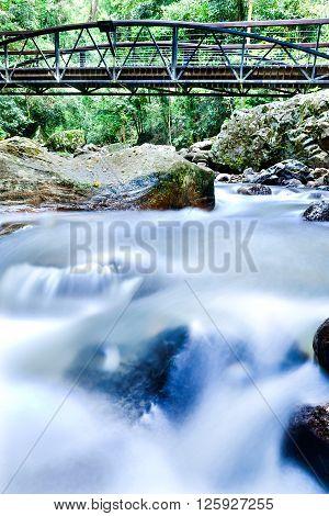 Colorful River Closeup Running Like A Smoke Through The Rocks