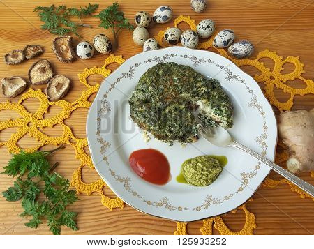 Cow parsley omelet on plate, Cooking with ginger, wild plants, Cow parsley and goutweed and quail eggs