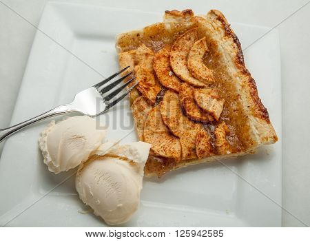 Freshly baked Apple Tart with ice cream.