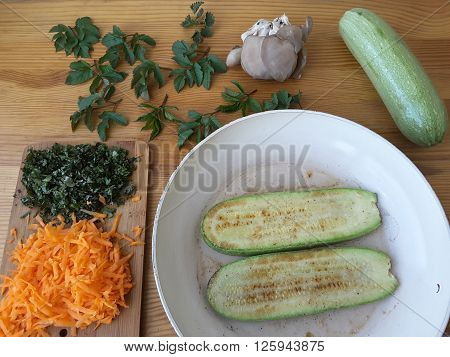 Squash oyster mushrooms goutweed puff with carrot, cooking with wild plants, with greenary