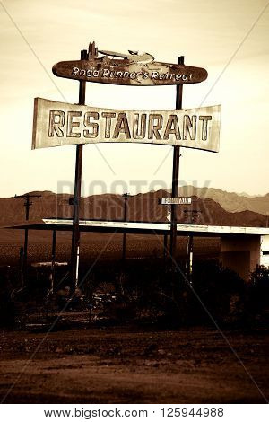 NEEDLES, UNITED STATES - DECEMBER 24: A dilapidated and ruined Restaurant on Route 66 near Needles in the wasteland of the Mojave Desert December 24 2015 in Needles.