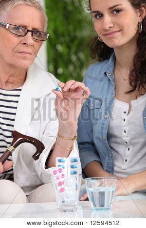 Senior woman taking drugs
