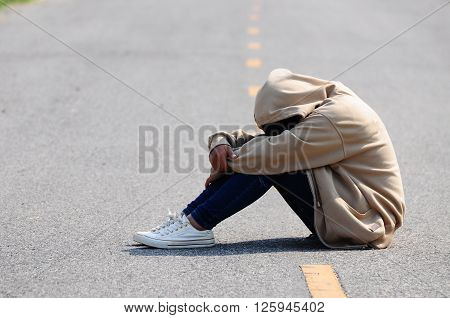 Sad and Nervous Girl Sitting on the Road