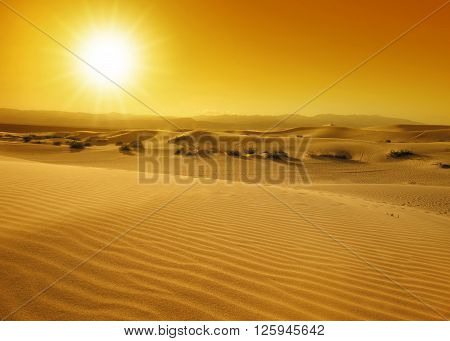 sunset over the sand dunes in the Death Valley